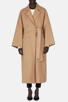 In a new chapter for Loewe, creative director Jonathan Anderson is adapting the storied Spanish house's signature techniques for pieces like this double-faced wrap coat, which envelops the body in an especially plush blend of wool and cashmere. The deliberately and dramatically oversized fit, accented by dropped shoulder seams and refined by side slits, creates one of fall's most desirable—and cozy—silhouettes.