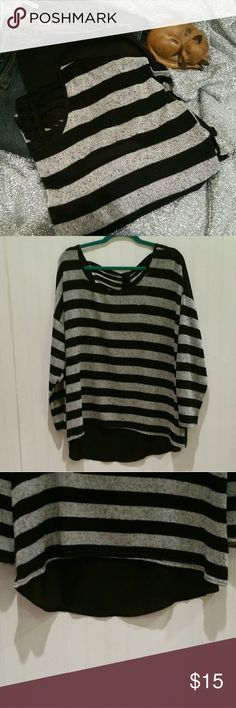 """Black & Grey Striped Cut Out Hi Low Shirt Light weight knit front shirt with black & grey stripes. Faux """"pocket"""" on the front. Back of shirt is hi low with cut outs starting at the neckline. Chiffon like black material makes up the back of the shirt. Long sleeve. Great for a Spring day. Size 2x & slightly oversized. Very comfy & great with dark wash jeans (several denim options in my closet). Pet friendly home. GUC Mine Too Tops Blouses"""