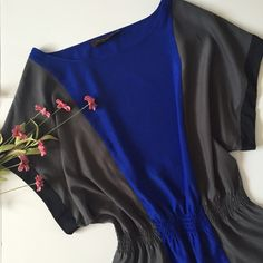 """⭐️HP⭐️ The Limited Colorblock Blouse Blue and Gray flowing top from The Limited! Features a cinched waste to flatter your shape. Has black trim on the sleeves. About 26"""" long, 27"""" wide (from each end of sleeve), neck opening 11"""", waist 13"""" laying flat unstretched and can stretch up to 21"""". 100% polyester. Great condition- was barely worn. NO TRADES. The Limited Tops"""