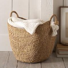 Basket for blanket and pillow living room