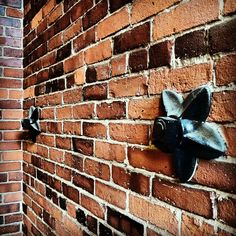 Canal St Mill, Somersworth NH - These anchor bolts and #Starshaped washers caught my eye. They brace the brick walls of the old mill building, originally built in 1875 for a textile manufacturer, now occupied by a variety of small businesses.
