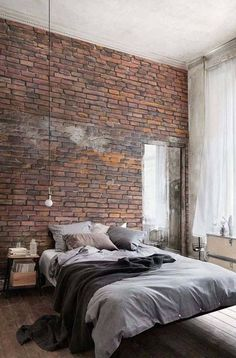 The brick in this bedroom is a wall decal, helping bring the industrial look into your space!