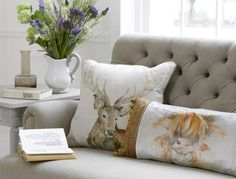 Highland cow and stag cushion