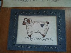 Felt square 'mat' with embroidered border, lamb cross stitch