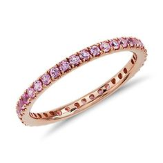 This gemstone eternity ring features a petite row of pink sapphires set in complimentary 18k rose gold.