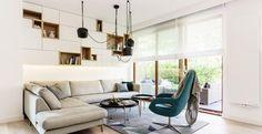 Il sapiente utilizzo di pezzi di design contemporaneo e materiali preziosi nella casa di una famiglia
