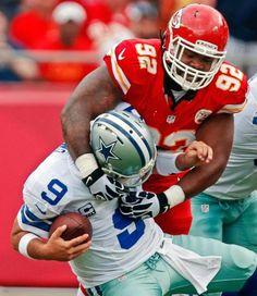 Dallas Cowboys quarterback Tony Romo (9) is sacked by Kansas City Chiefs nose tackle Dontari Poe