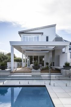 Wide steps create an easy transition from the outdoor room to a new pool and terrace.