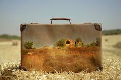 """In the nostalgic photo series """"Memory Suitcases,"""" Israeli artist Yuval Yairi painted faraway destinations on to old suitcases and then photographed the Old Luggage, Vintage Luggage, Recycled Art Projects, Old Suitcases, Ap Art, Vanitas, Travel Memories, Art Boards, Landscape Paintings"""