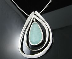 """You are viewing a brand new 16"""" .925 Sterling Silver Necklace with Ancient Roman Glass and Cut Out Hammered Design Pendant. An absolutely gorgeous piece, this necklace and pendant set is both stylish and feminine in appearance. Wearing a piece a history is a breath-taking experience in itself, however; wearing a modern-day, stylish design, and a piece of history all wrapped into one is unparalleled! Not to mention the incredible conversation this magnificent piece will start. Also, this…"""