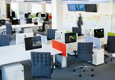 Open workspaces, with some personal space.