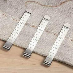 Clips that hold fabric in place and measure. Alternative to the traditional pins. Need that!!!