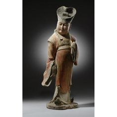 A LARGE AND STRIKING PAINTED POTTERY FIGURE  TANG DYNASTY