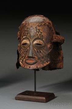 Africa | Mask from the Kuba people of DR Congo | Wood with pigment and fabric