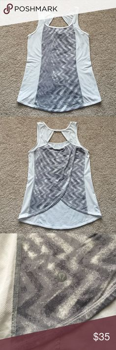 """Lululemon tank sz 4 Excellent condition open back tank ! 2 snags on front as shown in pic but hardly noticeable when wearing. Size tag removed but pretty sure it's a 4 as I normally wear 6 and this is tight. Bust measures 15.5""""'and length is 23.5"""" lululemon athletica Tops Tank Tops"""