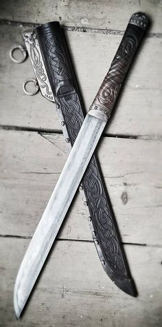 Looks like a really fancy seax.