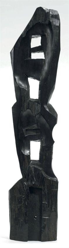 ALEXANDRE NOLL (1890-1970) A Unique Carved Ebony Sculpture, circa 1960 42 (106.8 cm.) high carved A Noll