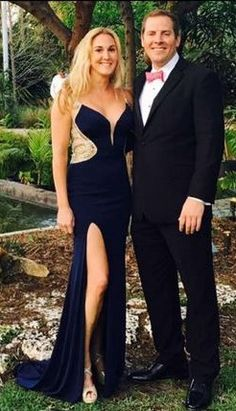 Fan Photo | Gin looks completely at ease in this stunning navy gown by Terani. Shop the Cobalt Sheer Galmour Gown #P0059 for your next formal event. The perfect designer dress rental!