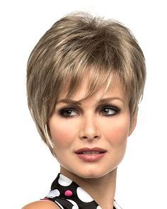 Nieci by Envy WIgs has asymmetrical layering with a touch of volume up top and long, brow-skimming bangs for a classy sophisticated look. Free Shipping in the US. Our Price: $119.75.
