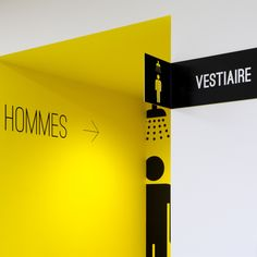 Wayfinding/signage for public restrooms or changing rooms. Black, yellow & white. www.parka-architecture.com