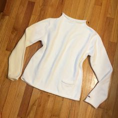 Tommy Hilfiger Classic Creamy White Sweater Single pocket on front. Slightly roll neck, sleeves, and hem. Tommy metal logo on left wrist. Well loved and cared for with price accounting wear (slight pilling). 20% off bundles! Thanks for looking! Tommy Hilfiger Sweaters