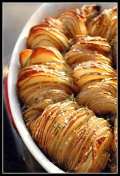 Crispy Potato Roast  2 Tbsp unsalted butter, melted   2 Tbsp extra-virgin olive oil   3 lbs russet potatoes   4 shallots, thickly sliced lengthwise   1 tsp coarse sea salt   8 sprigs thyme