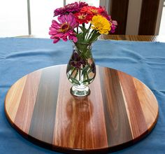 A Lazy Susan should be the center piece of the table. The striking contrast between the Canarywood, Bloorwood, Santos Rosewood really sets this Lazy Susan apart from the others. These are exotic woods and they come from Africa and South America. Price $135.00