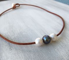 A personal favorite from my Etsy shop https://www.etsy.com/listing/263859822/freshwater-pearl-necklace-leather-pearl