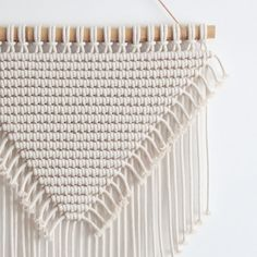 *** CLEARANCE SALE - 20% OFF *** Only 1 in stock!  This macrame wall hanging is hand-knotted using 100% cotton cord (braided, 5mm) in natural ecru with a bamboo supporting rod.  Approx Dimensions >  Width: 51cm / 20 inches Length: 65cm / 25.5 inches