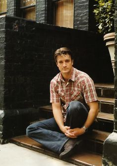 I'm 13 and think nathan fillion is hot and want I marry him. I wonder what gown women think of him! <3