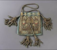 Drawstring bag  English, Late 16th–early 17th century  England  DIMENSIONS  Overall (without tassels and cord): 14.6 x 15.2 cm (5 3/4 x 6 in.)  MEDIUM OR TECHNIQUE  Silk satin embroidered with metallic thread, metal purl, Silk; Braided cords and tassels  CLASSIFICATION  Costumes  ACCESSION NUMBER  63.1368