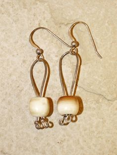 Handmade ancient mammoth ivory bead earrings, set with sterling silver hooks. Price: $45.00  -- on ScrimshawGallery.com #jewelry #earring #ivory