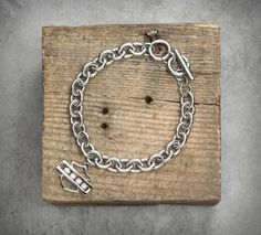 """Bling Bar & Shield Logo Bracelet - Stainless steel is hypoallergenic. Measures 7-1/2"""" plus 1"""" adjustable toggle closure. Sculpted Bar & Shield logo pendant features four moving Swarovski® crystals. Nickel free. 99418-14VW"""