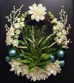 "Holiday 2014 Season ""EGG"" Grapevine Christmas Wreath: White Snapdragon, Dahlias and wild grass blooming blades with mint green wire and mesh poinsettia, white berry picks and powder blue ball. Original design and arrangement by http://nfmdesign.synthasite.com/"