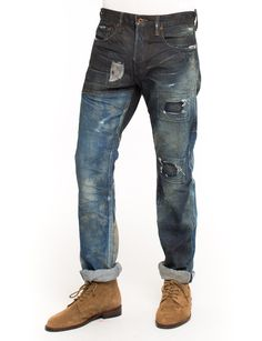It's all about the details with the PRPS Noir Pana Jean made from 13.5 oz cotton, featuring an ombre wash effect that is darker at the top of the jean and lighter at the bottom, highlighting patched sections and light rip. Demon fit is mid rise and slim