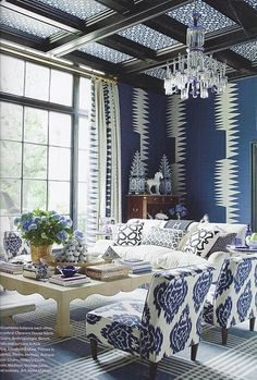 I love this blue and white living room. The mix of patterns and textures is great.
