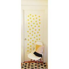 vinyl wall decals (close up)  Steps  1) Run vinyl (about 1/2 a yard) through Xyron using repositionable adhesive.  2) use circle punch (I used a 2 1/2 punch) to punch out circles  3) remove adhesive and stick on wall or door. It's that easy!  4) Enjoy!!!!