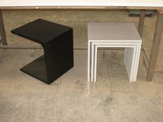 Two modern tables in one picture. One is a nest of tables, the other is a table that can slide under the couche and get up close and personal with you without banging into the legs or the under frame. Both for private clients. www.marquessmeubelkunst.nl