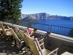 CRATER LAKE NATIONAL PARK  Oregon    Visitors to the Crater Lake Lodge can take in the views from the veranda and watch the sun rise over the lake in the morning.