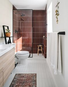 Lauren and Chase's Master Bathroom Remodel Reveal - The Effortless Chic - Oxblood / Rust / Brick Red Tile Color Vertical Stack Bond Stacked in Shower - Midcentury Modern - Home Bathroom Renovation Glass Tile Bathroom, Small Bathroom, Bathroom Ideas, Bathroom Organization, Shower Tiles, Glass Tiles, Bathroom Mirrors, Concrete Bathroom, Bathroom Inspo