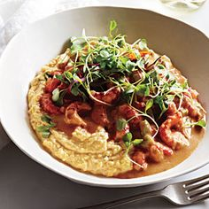 Saucy Crawfish with Whole Corn Grits. Substitute shrimp for the crawfish, if you prefer. Toasting the flour brings nutty flavor to the sauce, similar to a brown roux. Microgreens make an elegant garnish.