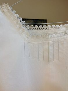 This is a French trousseau nightie from the 1920s. It is hand sewn from a very fine seamstress in some areas, old machine sewing in others. The neckline has hand pulled drawnwork and French peas, lace, a monogram HT and the flowing body fits fuller sizes Sewn with practically invisible