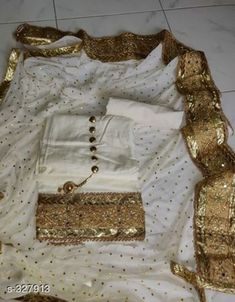 Semi Stitched Suits Elegant Silk Lace Border Suit Fabric: Top - Jam cotton Silk, Bottom - Cotton, Dupatta - Nazneen Size: Top - Up To 48 in, Bottom - 2 mtr, Dupatta - 2.25 mtr Type: Semi Stitched Work: Lace Borderr Sizes Available: Un Stitched, Semi Stitched *Proof of Safe Delivery! Click to know on Safety Standards of Delivery Partners- https://ltl.sh/y_nZrAV3  Catalog Rating: ★4.1 (6150)  Catalog Name: Lace Bordered Silk Salwar Suits & Dress Materials Vol 1 (Replica) CatalogID_34729 C74-SC1522 Code: 417-327913-