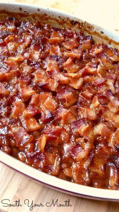 A classic Southern-style baked beans recipe made with brown sugar topped with bacon. Southern-Style Baked Beans - South Your Mouth: Southern Style Baked Beans Baked Beans With Bacon, Pork N Beans, Southern Baked Beans, Baked Beans Crock Pot, Baked Beans Recipe Brown Sugar, Grandma Browns Baked Beans Recipe, Baked Pork And Beans Recipe, Baked Beans Recipe Easy Quick, Cowboy Baked Beans