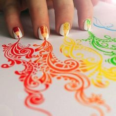 VERY COOL!!!!!  Intricate design on paper leads up to a pencil crayon mani over white!!!!!  A MASTERPIECE!!!!