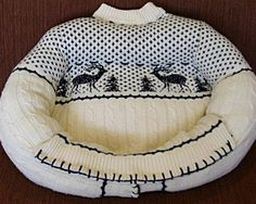 Wooly Buddy bed    Cats and dogs love curling up in your clothes. Whether it's your sweaty gym shorts or your freshly laundered sweater, these items seem to be irresistible to pets — and their fur. So why not give your furry friend a sweater of his own? Wooly Buddy Beds are handmade from thrift store sweaters, and 5 percent of the proceeds is donated to animal shelters.