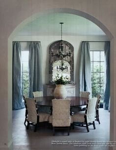 Elegant luxurious dining room. Interior design by MILIEU editor Pamela Pierce (French, Swedish, Belgian, European, Gustavian, Scandinavian antiques, modern art, minimal, feminine, romantic, timeless, tranquil, farmhouse, elegant, traditional decor with reclaimed stone, biots, white roses, linen, slipcovers, ruffles, skirted tables, Lefroy Brooks, cremone bolts, steel windows and doors, rustic wood, white, neutrals, country, Chateau Domingue, oversize sconces, and chandeliers. Dining Room Inspiration, Interior Inspiration, Home Design, Design Room, Round Dining Table, Dining Chairs, Dining Area, Round Tables, Room Chairs