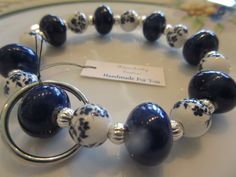 Handmade For You Hands-Free Beaded Bracelet KeyChain Keyring Navy Blue and White Floral Ceramic, Silver Stretch Cord Fits Many Sizes K144 by JewelsHandmadeForYou on Etsy