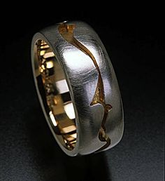 The page for classically beautiful rings in colored and high carat gold, sterling and gemstones. Hand- made, forged and fabricated in Seattle by Andy Cooperman
