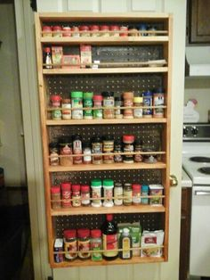 Spice rack made by my husband! Using pine for the sides and shelves and peg board for the back.